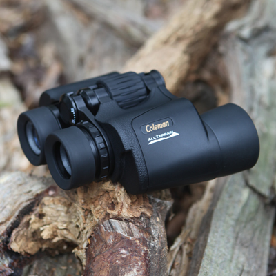 COLEMAN<sup>®</sup> Wide View Binoculars - Bring your world into focus with these high-resolution binoculars. Covered with durable rubber armor, they also feature anti-glare coated optics, center focus control, long-eye relief ocular lenses and 7x50 magnification.  Includes carrying case with strap and lens cover.