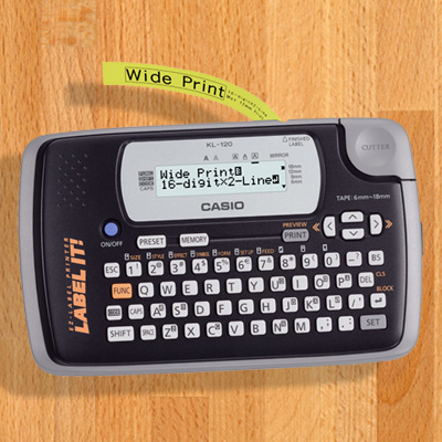 CASIO<sup>®</sup> Portable Thermal Label Maker - Organize your life with easy-to-make identifying labels! This portable thermal printer is simple and ideal for home, school, or the office. It features a 16-digit LCD display with 2 lines, one built-in font and 24 character sizes. It also has an easy-to-use keyboard that helps you label and print whatever you want!